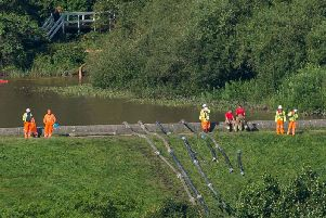 Members of the emergency services pump water from Toddbrook Reservoir. Photo: Roland Harrison/AFP/Getty Images.