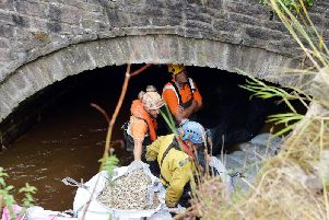 Engineers make repairs to the damaged bridge. Photo: Brian Eyre.
