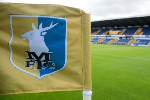 Three members of staff have left Mansfield Town.