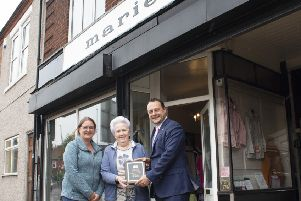 Ann Cooper (centre), the current owner of the Marie gown shop, receives her plaque from Coun Jason Zadrozny, leader of Ashfield District Council, and Coun Samantha Deakin.