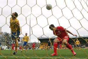 MANSFIELD, UNITED KINGDOM - JANUARY 26:  Jake Buxton of Mansfield Town heads the ball in to his own net under pressure from Stewart Downing of Middlesbrough to score an own goal during the FA Cup 4th round match sponsored by E-on at Field Mill on January 26, 2008 in Mansfield, England.  (Photo by Alex Livesey/Getty Images)
