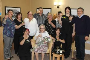 Baily House staff celebrating its first ever resident a few years ago.