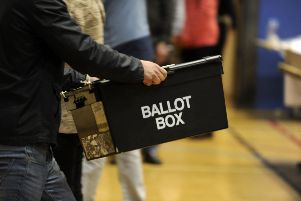 Ballot boxes are carried into the hall at the Richard Dunn Centre, Bradford,  for counting in the 2015 General Election.  7 May 2015.  Picture Bruce Rollinson