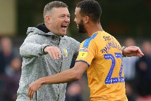 Celebration between Mansfield Town Manager John Dempster and midfielder CJ Hamilton.
