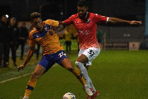 Mansfield's Kellan Gordon battles with Salford's Jake Jervis