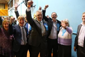 Lee and supporters celebrate.