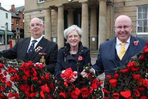 Michael Beresford of the Mansfield branch of the Royal British Legion, Executive Mayor Kate Allsop and deputy mayor Mick Barton with part of last year's netting and some recently donated poppies