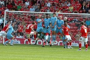 Kieran Tripper scores a late goal for Barnsley against Doncaster Rovers from a free kick in 2011.