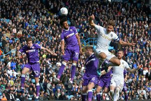 Derik Osede Prieto beats Eunan O'Kane to a corner ball.'Leeds United v Bolton Wanderers.  SkyBet Championship.  Elland Road.'30 March 2018.  Picture Bruce Rollinson