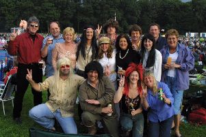 2002: A fabulous bygone shot from the 60s concert at Clumber Park. Do you recognise anyone you know on this group shot?