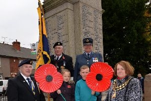 The launch of the Poppy Appeal at Kirkby's war memorial in 2015.