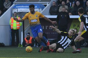 Picture by Howard Roe/AHPIX.com;Football;Skybet; 'Notts County v Mansfield Town'16/2/2019  KO 1.00pm; Meadow Lane;'copyright picture;Howard Roe;07973 739229''Stag's Jacob Mellis challenged by Countys Craig Mackail-Smith