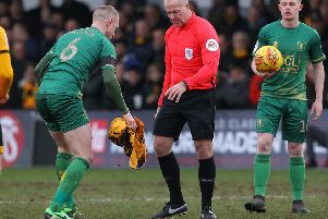 Picture by Gareth Williams/AHPIX.com; Football; Sky Bet League Two; Newport County v Mansfield Town; 9/2/2019  KO 15.00; Rodney Parade; copyright picture; Howard Roe/AHPIX.com; Mansfield's Neil Bishop clears blood of the pitch under instruction of referee Graham Salisbury following Danny Rose's head injury