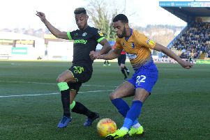 CJ Hamilton crosses against Forest Green.