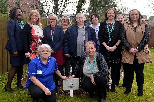 Exemplar Health Care staff celebrating 10 years of care at Eastlands, Meadowcroft and Pathways,with the plaque to commemorate the milestone