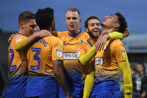 Mansfield's players celebrate a goal.