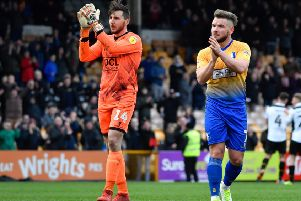 Mansfield Town's Alex MacDonald and Jordan Smith salute the travelling Stags fans after their defeat: Picture by Steve Flynn/AHPIX.com, Football: EFL League 2 match Port Vale -V- Mansfield Town at Vale Park, Burslem, Staffordshire, England on 09/03/2019: copyright picture Howard Roe 07973 739229