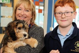 Head teacher, Helen Thomas with year six pupil Euan who suggested that Ravenshead Church of England Primary School get a dog.