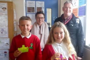 Rob Hurd and Beth Hutton from Life Church with two Berry Hill pupils with their Easter baskets.