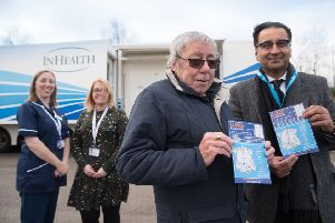 Pictured left to right at the mobile lung scanner in Strelley: 'Members of the Citycare respiratory team, Joanne Adkin and Emma Waring 'Bill Simpson (from Bulwell) who was diagnosed with early stage lung cancer in October 2017 and has been successfully treated.'Dr Safiy Karim, CCG Cancer Lead for Nottingham City