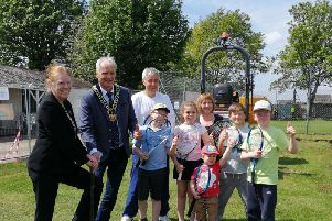 Councillor Joyce Bosnjak, Coun Kevin Rostance, and representatives and members of the tennis club at the official launch of the new clubhouse development.
