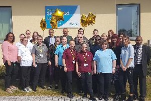 The team at Sherwood Lodge celebrate their 'outstanding' CQC rating across all five categories.