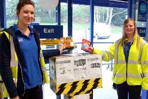 Leah Hughes and Jen Burton from Wickes putting the school's crisp packets into the Wickes collection box.