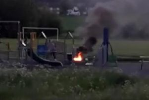 Youngsters pictured at a fire at the Carrs playground Warsop.
