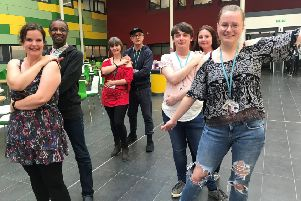 Staff and students at West Nottinghamshire College perform an end-of-term 'flash mob' to a dance routine to raise awareness of mental health.
