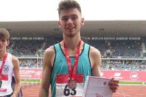 Luke Duffy, of Mansfield Harriers, with his bronze medal at the English Schools Championships.