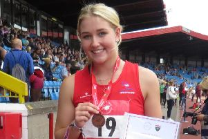 Kelsey Pearce with her medal at the English Schools' Championships.