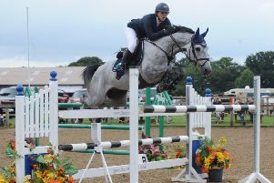 Beth Vernon and Pewit Dezoito on their way to victory. (PHOTO BY: British Showjumping)