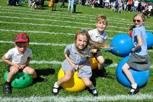 Bouncing along on the space hoppers are (from left) Luke Reynolds, Lily Reynolds, Zach Kedzior and Evie Harrison. (PHOTO BY: Louise Brimble)