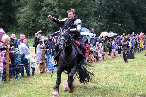 Villain of the peace the sheriff of Nottingham rides onto the jousting arena.