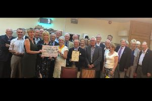 Rotary Club of Mansfield awarding the check.
