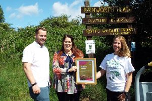 James Miles and Kate Summerfield-Breeze of Kingfisher Lighting being presented their certificate by Holly McCain (right) from Nottinghamshire Wildlife Trust.