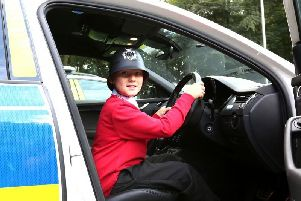 Rufus had the chance to sit in a police car