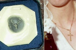 Items stolen included a gold and black onyx signet ring with an engraved stag's head on it (photogragh shows design for the engraving) and an antique gold cross inset with small pearls on an unusual gold chain.