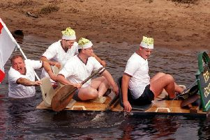 Paddling for England... The Grapes raft team , landlord, Gary Wright (second left) and his crew, Jimmy Blaylock, Steve Kenyon and Tony Rowe head for last place in the raft race on the River Wyre at St Michaels. The event was part of a charity Fun Day at The Grapes pub, with proceeds going to Brian House Children's Hospice in Bispham