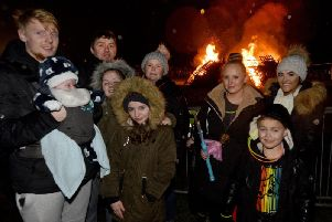 Children and adults all enjoy the bonfire at Astley Park, Chorley Bonfire and Fireworks night