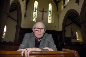 Rev Peter Smith at St Peter's Church, where fund-raising continues to save two stained glass windows and the bell tower (Image: JPIMedia)