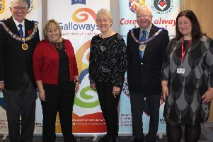 Leader of West Lancashire Freemasons Tony Harrison with partially sighted service users Linda McCann from Preston and Laurel Devey from Southport together with Nicola Hanna from Galloways Society for the Blind