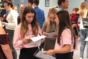 Pupils celebrate their GCSE results in August 2018.