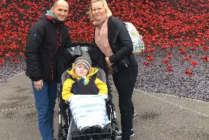 Mum, dad and Jude geting out and about thanks to the special buggy