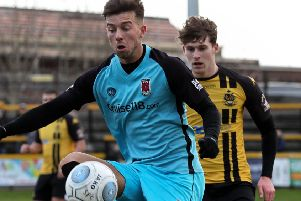 Alex Newby controls the ball during Chorley's defeat at Southport (photo: Josh Vosper)
