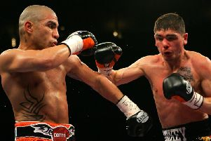 Michael Jennings goes on the offensive against Miguel Cotto on his big night in New York 10 years ago. Picture: Getty Images