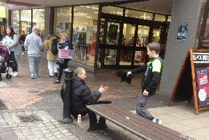 Cody offers a helping hand to a homeless man in Preston