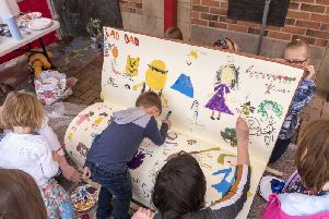 Children decorating a bench for Whats Your Story, Chorley?
