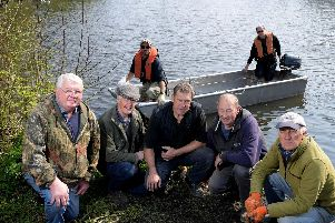 Environment Agency and Withnell Angling Club teaming up to bring siltex to Farington Lodges Recreation Ground to break up silt in the water (Images: JPIMedia)