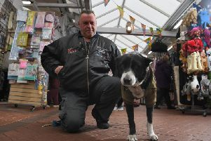 Professional medium Ian and his dog Basil, ready for the Ghost Hunt taking place at Chorley Market